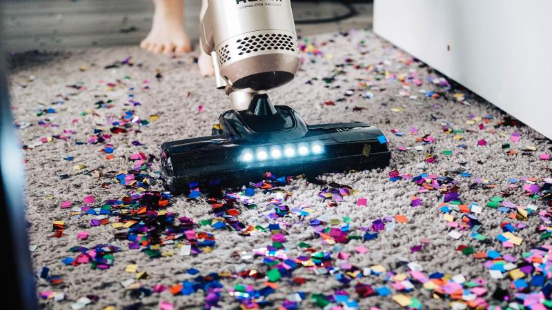 Vacuuming Confetti After Party